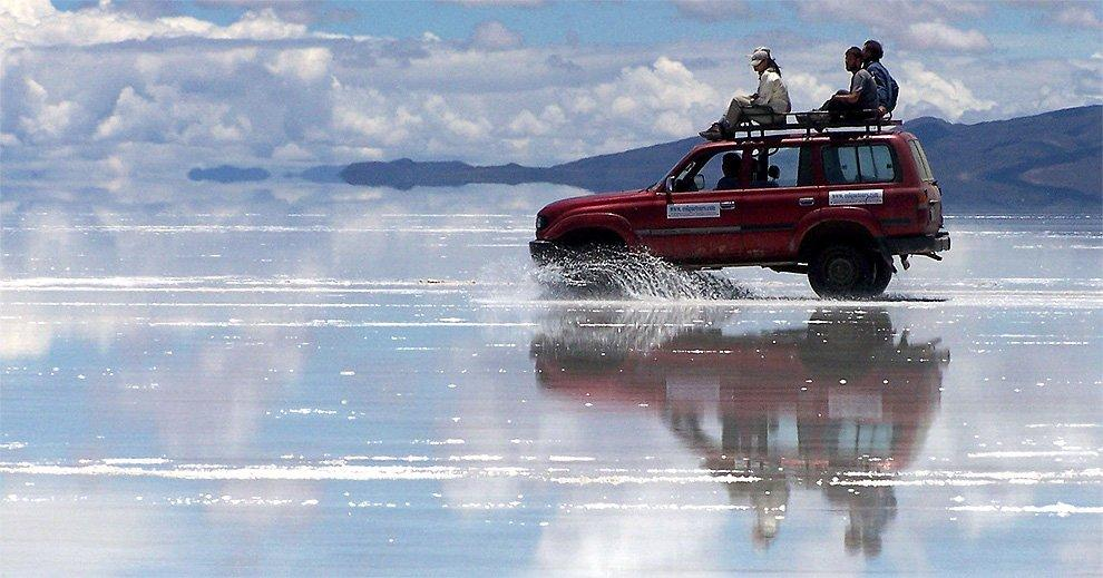 Driving on the flooded salar
